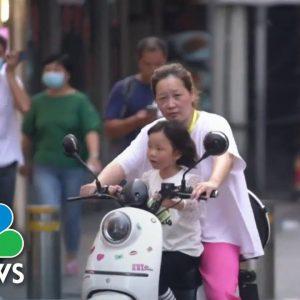 China Pushes Three Child Policy